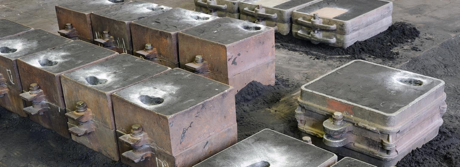 Foundry, sand molded casting, molding flasks ready for casting